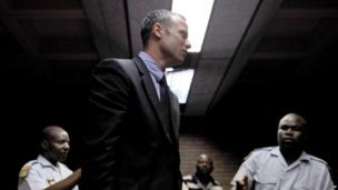 Oscar Pistorius leaves court in Pretoria, 15 February