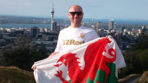 Swansea boy Dean Williams standing on top of Mount Eden with the city of Auckland, New Zealand behind
