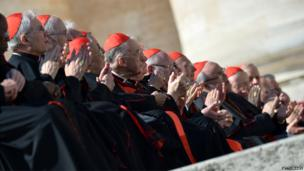 Cardinals applaud Pope Benedict XVI as he arrives on the altar at St Peter's Square, 27 February 2013
