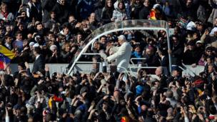 Pope Benedict XVI waves from his popemobile, 27 February 2013