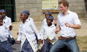 Prince Harry dances with deaf children