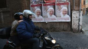 Posters wish Pope Benedict XVI farewell after giving his final general audience in St Peter's Square