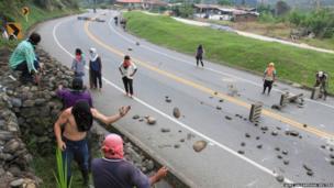 Protesters throw rocks onto the Pan-American highway in Piendamo, Cauca
