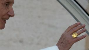 "Pope Benedict XVI waves while wearing his ""Fisherman's Ring"", as he arrives on St Peter's square for his last weekly audience on Wednesday"