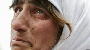 A woman in St Peter's Square reacts to the departure of Pope Benedict XVI on Thursday