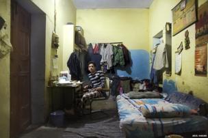 Nuradeen Sahdee in his cluttered university room