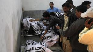 elatives search for bodies of their loved ones in a morgue in Karachi. Photo: 3 March 2013