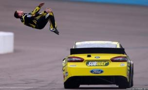 Carl Edwards performs a back flip