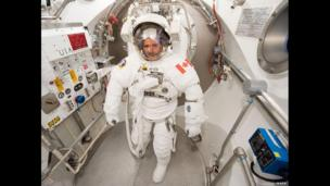 Chris Hadfield participates in a spacesuit fit check