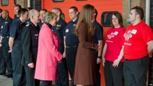 Duchess of Cambridge talking to people