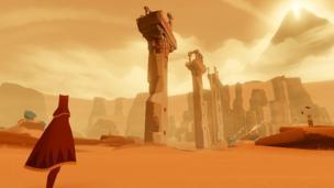 A robed figure stares across a vast desert.