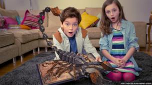 Children play with the Playstation's wonderbook.