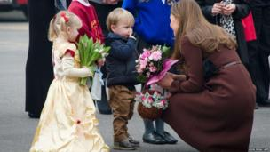 A young boy talks to the Duchess of Cambridge