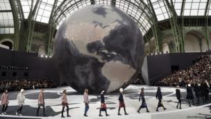 Models present creations for Chanel at the Grand Palais in Paris.