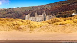 Harlech castle viewed from sand dunes