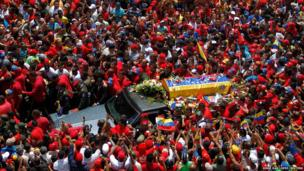 The coffin of Venezuela's President Hugo Chavez is driven through the streets of Caracas after leaving the military hospital where he died