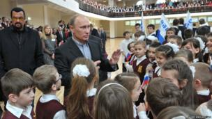 Steven Seagal and Vladimir Putin meet Russian schoolchildren