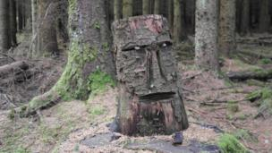 Face carved into a tree trunk