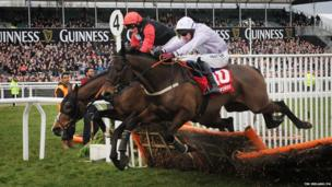 Paul Carberry on Solwhit (right) rides to victory in the World Hurdle Race