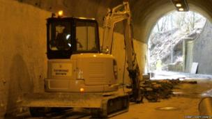 A digger inside Beaminster Tunnel