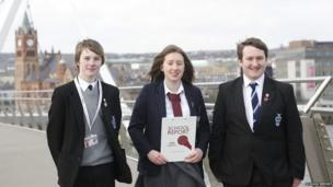 School Reporters in front of the Peace Bridge in Derry/Londonderry live on BBC Radio Foyle (mixed schools)