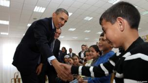 US President Barack Obama shakes hands with a Palestinian child in Ramallah, 21 March