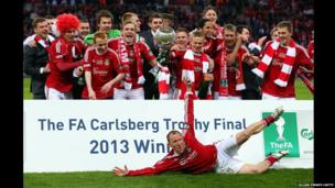 Wrexham players celebrate winning the FA Trophy