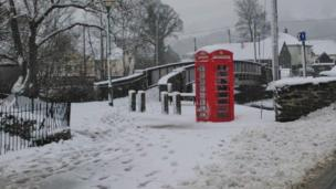 Phone box in snow