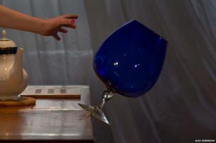 Large glass falling off a table