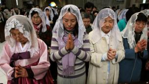 Catholics at the Myeongdong Cathedral in Seoul, South Korea, 31 March