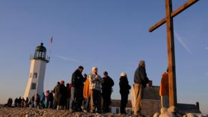 American Christians pray during an Easter sunrise service in Scituate, Massachusetts, 31 March