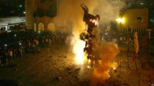 Judas effigy burns in Santa Rosa Xochiac church, in Mexico City.