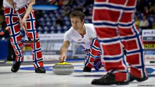 Norway's Thomas Ulsrud delivers a shot during their game against China at the World Men's Curling Championships in Victoria