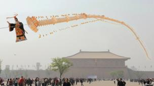 A 138m (450ft) kite in the shape of the Great Wall of China and the country's first emperor Qin Shi Huang in Xian