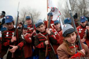 Hungarian youths attend a re-enactment of a battle between Hungarian hussars and Austrian soldiers