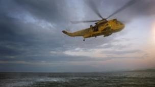 Search and rescue helicopter in flight over the sea, piloted by Prince William