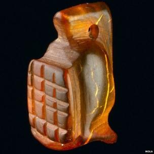 Amber amulet in the shape of a gladiator's helmet