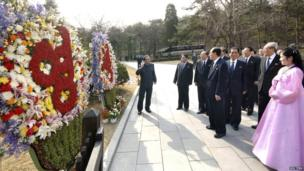 North Korean party officials visit Mankyongdae, the birthplace of North Korean founder Kim Il-sung, on the 101st anniversary of his birth, in Pyongyang in this photo distributed by North Korea's official Korean Central News Agency (KCNA) on April 15, 2013