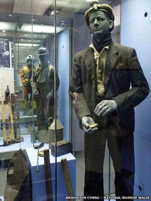 A display case at the Pitheads Baths at Big Pit showing miners' dress and tools