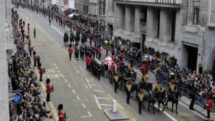The funeral procession of former British prime minister, Margaret Thatcher, travels along Fleet Street to her funeral service.