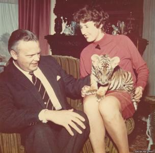 The Farrars' secretary, Joan Honisett, and her husband, Fred, with a Colchester Zoo tiger cub in about 1969