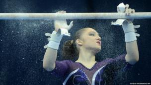 Russia's Aliya Mustafina prepares to compete on the uneven bars