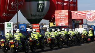 Police motorcycles lines up at the London marathon.