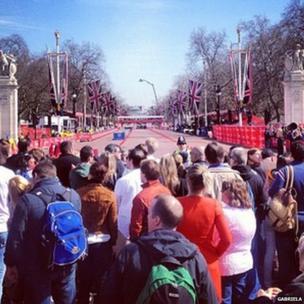 Spectators wait at the finishing line on The Mall. Photo: Gabriela