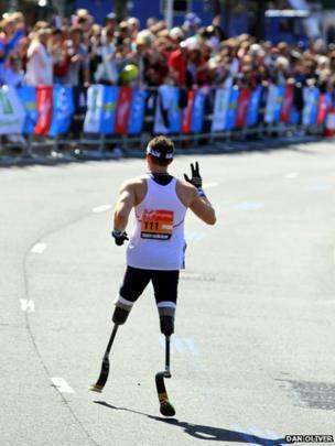 British Paralympic athlete Richard Whitehead waves. Photo: Dan Oliver
