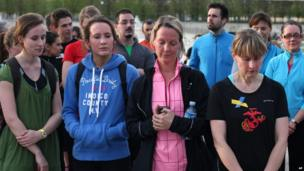 Runners observe a moment's silence in Paris, France, 22 April