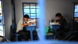 Students prepare for a college entrance examination in a tent in Lunshan County of Yaan, China