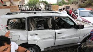A damaged car is seen near the French embassy (unseen) in Tripoli following a car bomb attack, on April 23, 2013.