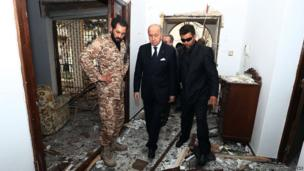 French Minister Laurent Fabius inside the bombed embassy in Tripoli, Libya (23 April 2013)