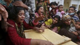 Relatives grieve over coffin of victim in Dhaka building collapse. 27 April 2013